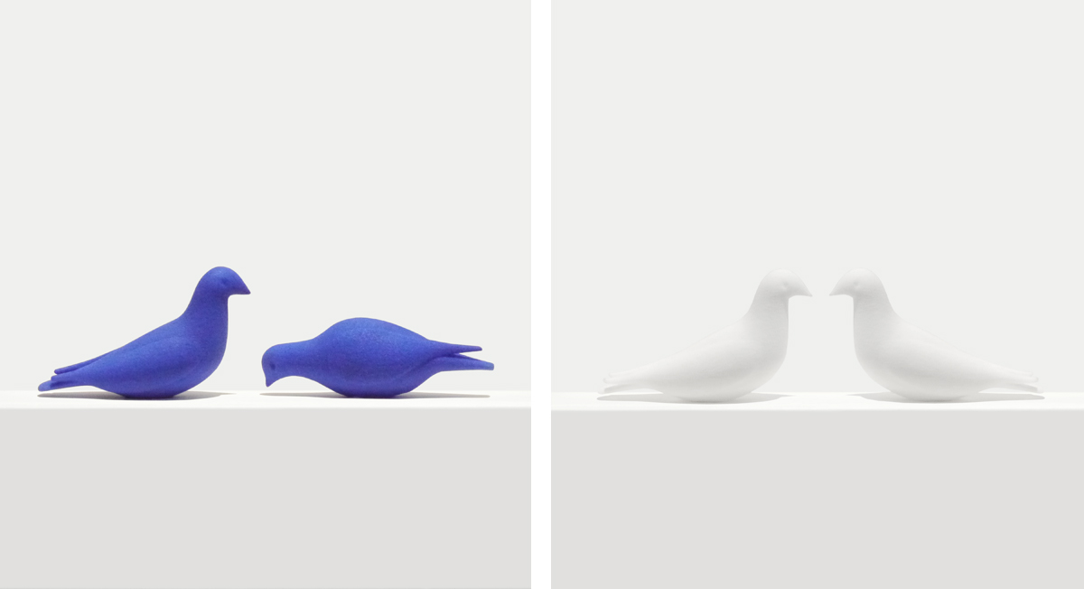 Bookmarks shaped as 3D printed doves in blue and white, perching blue dove, perching white doves kissing, pecking blue dove