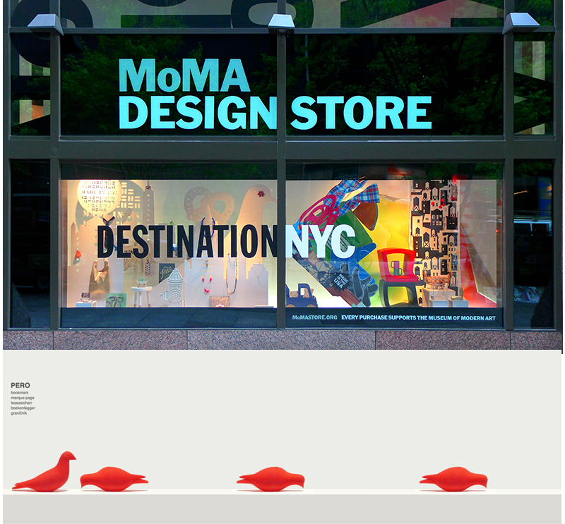 street view of moma design store in nyc with 4 red printed bird bookmarks from studio macura pecking bird and standing bird