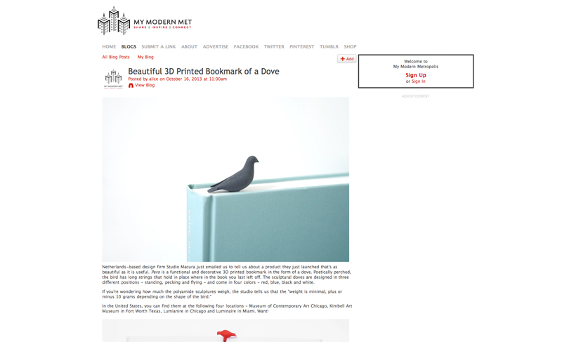 dove bookmark perched atop a blue book on the website of My Modern Metropolis