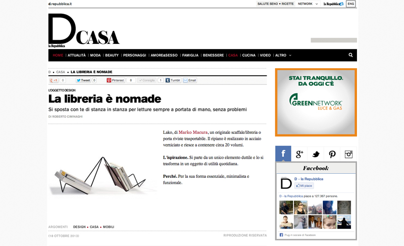 Black lako magazine rack with books on it featured on the internet page of D Repubblica Italia
