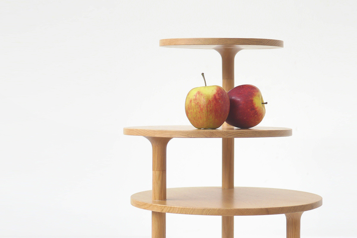 Close up of lipa side oak table with two apples on the surface